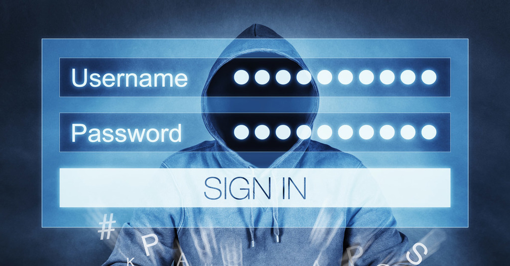 2020 election cybersecurity fears represented by a man in a hoodie is shown with a login screen superimposed to represent passwords for sale on the Dark Web